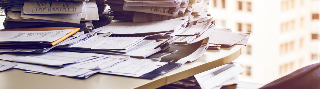 Piling paperwork and messy desks